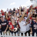 Fans cheer for Houston Texans defensive end J.J. Watt to come sign autographs after an NFL football training camp practice Sunday, July 27, 2014, in Houston The Associated Press