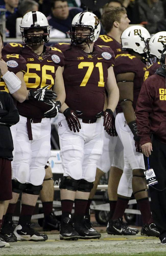Minnesota coach Jerry Kill, right, looks at the scoreboard during the second half of the Texas Bowl NCAA college football game against Syracuse, Friday, Dec. 27, 2013, in Houston. Syracuse won 21-17