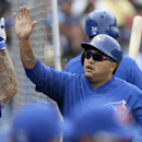 Toronto Blue Jays' Dioner Navarro celebrates with teammates after scoring a run during the fifth inning of an exhibition baseball game against the Tampa Bay Rays Friday, March 7, 2014, in Dunedin, Fla The Associated Press