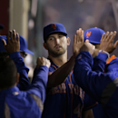 New York Mets starting pitcher Jonathon Niese, center, is greeted by teammates after he was relieved during the eighth inning of a baseball game against the Los Angeles Angels on Saturday, April 12, 2014, in Anaheim, Calif The Associated Press