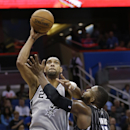 San Antonio Spurs' Tim Duncan, left, makes a shot over Orlando Magic's Glen Davis (11) during the second half of an NBA basketball game in Orlando, Fla., Friday, Nov. 29, 2013. San Antonio won 109-91 The Associated Press