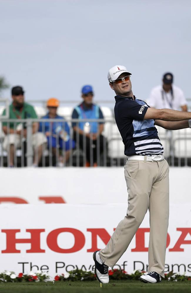 Golfer Zach Johnson tees off on the 17th hole during the first round of the Honda Classic golf tournament, Thursday, Feb. 27, 2014 in Palm Beach Gardens, Fla