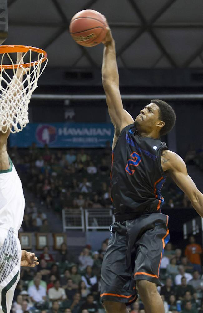 Boise State guard Derrick Marks (2) dunks the basketball on Hawaii guard Garrett Nevels (1) in the first half of an NCAA college basketball game at the Diamond Head Classic Sunday, Dec. 22, 2013, in Honolulu