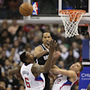 Brooklyn Nets' Shaun Livingston, top, passes the ball as he is defended by Los Angeles Clippers' DeAndre Jordan, left, and Blake Griffin during the first half of an NBA basketball game on Saturday, Nov. 16, 2013, in Los Angeles The Associated Press