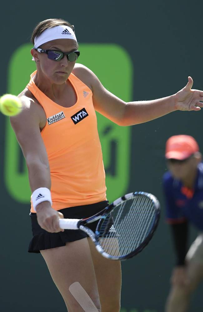 Kirsten Flipkens, of Belgium, returns to Maria Sharapova, of Russia, at the Sony Open tennis tournament, Monday, March 24, 2014, in Key Biscayne, Fla