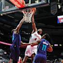 ATLANTA, GA - OCTOBER 20: Paul Millsap #4 of the Atlanta Hawks dunks against the Charlotte Hornets on October 20, 2014 at Philips Arena in Atlanta, Georgia. (Photo by Scott Cunningham/NBAE via Getty Images)