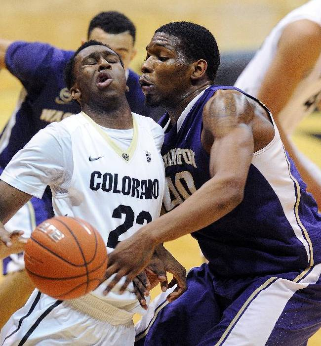 Jaron Hopkins, left, of Colorado, collides with Shawn Kemp of Washington during the second half of an NCAA college basketball game in Boulder, Colo., Sunday, Feb. 9, 2014