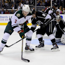 Minnesota Wild center Charlie Coyle (3) tries to get a shot by Los Angeles Kings defenseman Drew Doughty (8) and goalie Jonathan Quick (32) during the third period of an NHL hockey game, Monday, March 31, 2014, in Los Angeles. The Wild won 3-2 The Associa