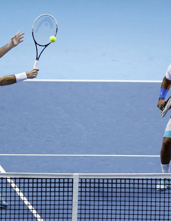 Radek Stepanek of Czech Republic, left, and Leander Paes of India play a return to Alexander Peya of Austria and Bruno Soares of Brazil during their ATP World Tour Finals tennis match at the O2 Arena in London, Tuesday, Nov. 5, 2013