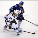 Minnesota Wild center Mikael Granlund (64) fights for control of the puck with Vancouver Canucks left wing Daniel Sedin (22) during the third period of NHL action in Vancouver, British Columbia, Canada, Sunday, Feb. 1, 2015 The Associated Press