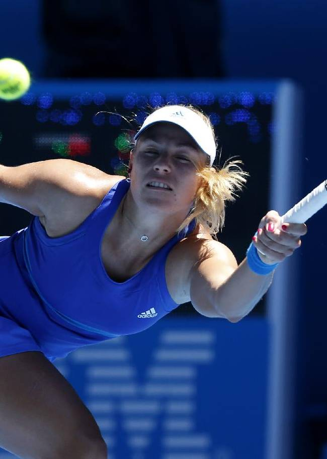 Angelique Kerber of Germany makes a forehand return to Jarmila Gajdosova of Australia during their first round match at the Australian Open tennis championship in Melbourne, Australia, Monday, Jan. 13, 2014