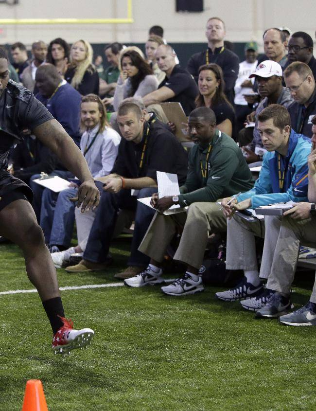 Baylor offensive lineman Kelvin Palmer leaps in the broad jump during pro day for NFL football representatives on Wednesday, March 19, 2014, in Waco, Texas
