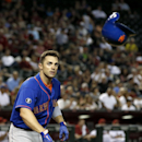 New York Mets' David Wright throws his helmet after striking out against the Arizona Diamondbacks during the sixth inning of a baseball game on Monday, April 14, 2014, in Phoenix The Associated Press