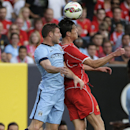 Manchester City forward Stevan Jovetic, left, challenges Liverpool defender Martin Kelly for a header in the first half of a Guinness International Champions Cup soccer tournament match, Wednesday, July 30, 2014, at Yankee Stadium in New York