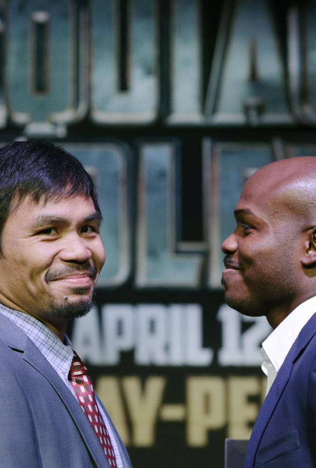 Boxer Manny Pacquiao, left, of the Phillipines, glances back during a photo opportunity with Timothy Bradley of Indio, Ca., the current WBO World Welterweight champion, during a press conference,Thursday, Feb. 6, 2014, in New York.  The pair will face off in a WBO World Welterweight title fight April 12, 2014, in Las Vegas