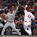 Pittsburgh Pirates first baseman Gaby Sanchez, left, catches a high throw from third baseman Pedro Alvarez to make the out on Cincinnati Reds' Devin Mesoraco (42) to end the fourth inning of a baseball game, Tuesday, April 15, 2014, in Cincinnati The Asso