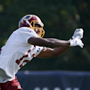 Washington Redskins receiver Andre Roberts misses a pass during practice at the team's NFL football training facility, Saturday, July 26, 2014 in Richmond, Va. (AP Photo) The Associated Press