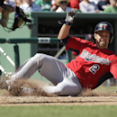Minnesota Twins' Brian Dozier scores on an RBI-single hit by Twins' Trevor Plouffe in the fourth inning of an exhibition baseball game against the Boston Red Sox, Friday, Feb. 28, 2014, in Fort Myers, Fla. The Twins won 8-2 The Associated Press