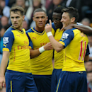 Arsenal's Mesut Ozil, right, celebrates with Aaron Ramsey, left, Alex Oxlade-Chamberlain, second left, and Danny Welbeck after scoring against Villa during the English Premier League soccer match between Aston Villa and Arsenal at Villa Park, Birmingham,