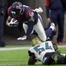 Houston Texans strong safety Danieal Manning (38) is tackled by Jacksonville Jaguars linebacker Jeremiah George (54) while returning a punt during the first half of an NFL football game Sunday, Dec. 28, 2014, in Houston. (AP Photo/David J. Phillip)