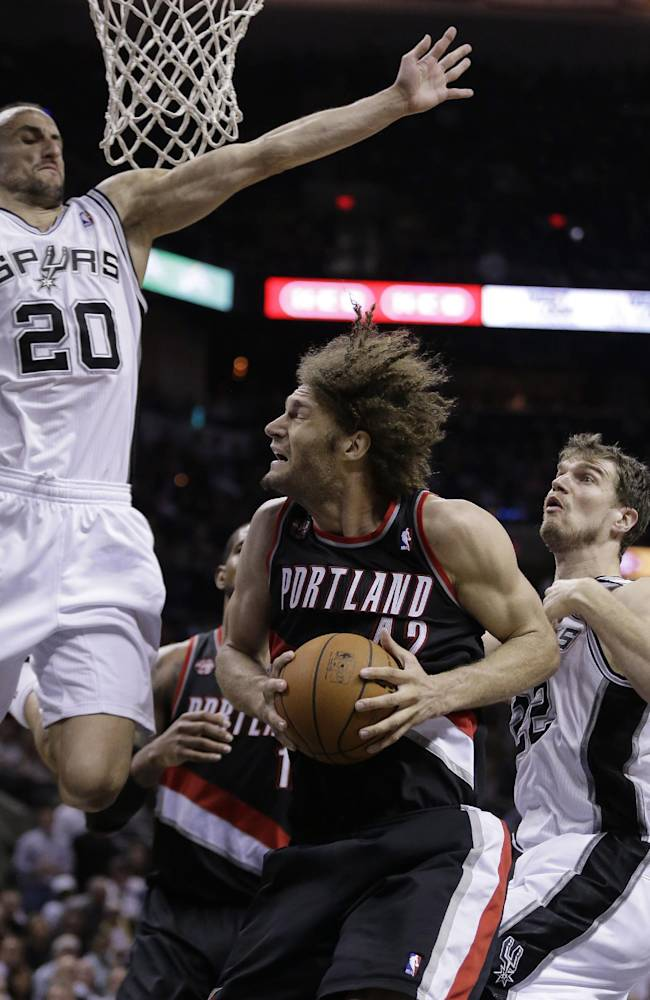 Portland Trail Blazers' Robin Lopez (42) is pressured by San Antonio Spurs' Manu Ginobili (20), of Argentina and Tiago Splitter, right, of Brazil, during the second half of Game 2 of a Western Conference semifinal NBA basketball playoff series, Thursday, May 8, 2014, in San Antonio. San Antonio won 114-97