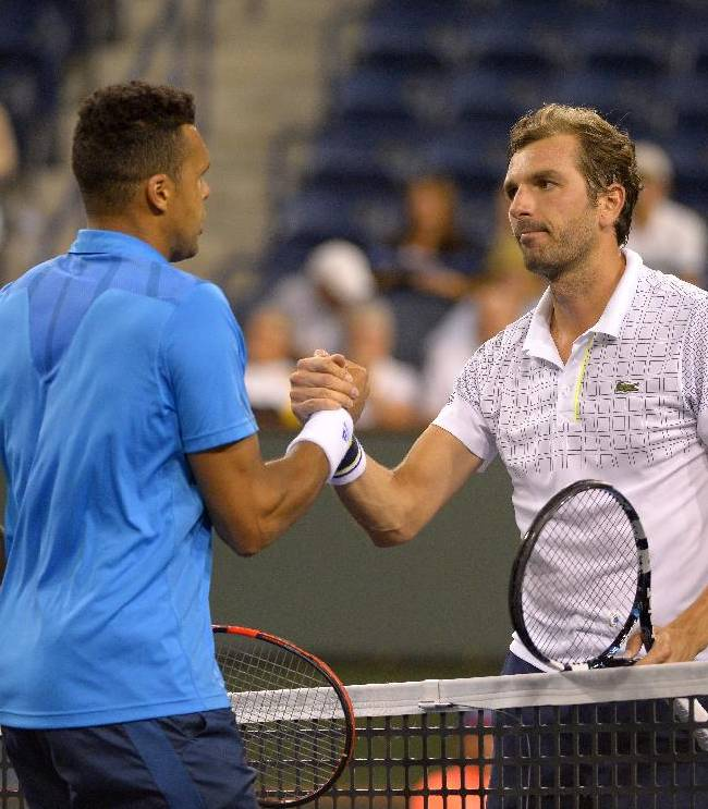 Julien Benneteau, right, of France, shakes hand with Jo-Wilfried Tsonga, of France, during their match at the BNP Paribas Open tennis tournament, Sunday, March 9, 2014, in Indian Wells, Calif. Benneteau won 6-4, 6-4