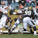 Cleveland Browns quarterback Brian Hoyer, left, throws a pass during the first half of an NFL football game against the Jacksonville Jaguars in Jacksonville, Fla., Sunday, Oct. 19, 2014. Hoyer completed just 16 of 41 passes for 215 yards and threw a late
