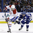 Tampa Bay Lightning left wing Ondrej Palat. right, of the Czech Republic, hooks Montreal Canadiens left wing Rene Bourque (17) as Bourque goes in on a breakaway during the first period of an NHL hockey game Tuesday, April 1, 2014, in Tampa, Fla The Associ