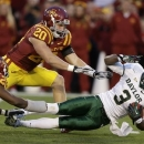 Baylor wide receiver Lanear Sampson, right, is tackled by Iowa State defensive back Deon Broomfield, left, and linebacker Jake Knott (20) after making a reception during the first half of an NCAA college football game, Saturday, Oct. 27, 2012, in Ames, Iowa. Iowa State won 35-21. (AP Photo/Charlie Neibergall)