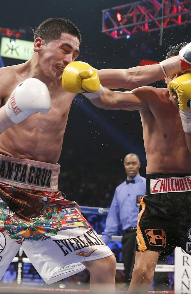 Leo Santa Cruz, left, trades punches with Cristian Mijares during their WBC super bantamweight boxing match, Saturday, March 8, 2014, at The MGM Grand Garden Arena in Las Vegas. Santa Cruz won by unanimous decision