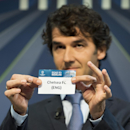 Former German soccer player Karl-Heinz Riedle, and ambassador for the UEFA Champions League final in Berlin, shows a ticket with British soccer team Chelsea FC during the draw of the round of 16 of the UEFA Champions League 2014/15 soccer matches in N