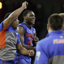 Florida's Michael Frazier (20) celebrates with his teammates as they defeat South Carolina 72-46 in their NCAA college basketball game Tuesday, March 4, 2014, in Columbia, S.C. Frazier had a total of 37 points. (AP Photo/Mary Ann Chastain)