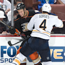 The Ducks' Ryan Getzlaf is checked by the Sabres' Josh Gorges during the Ducks' 4-1 victory over the Buffalo Sabres at Honda Center Wednesday night Oct. 22, 2014 The Associated Press