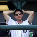 Detroit Tigers starting pitcher Max Scherzer stands in the dugout during an exhibition spring training baseball game between the Detroit Tigers and the Pittsburgh Pirates in Lakeland, Fla., Tuesday, March 4, 2014. Scherzer did not pitch in the game. The