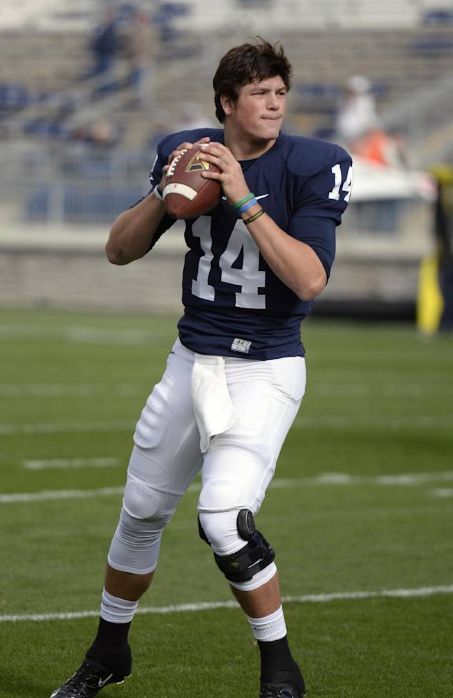 Penn State quarterback Christian Hackenberg warms up before an NCAA college football game against Illinois in State College, Pa., Saturday, Nov. 2, 2013