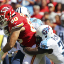 Kansas City Chiefs tight end Anthony Fasano (80) is tackled by Tennessee Titans safety Bernard Pollard, right, and nose tackle Sammie Hill (94) in the first half of an NFL football game in Kansas City, Mo., Sunday, Sept. 7, 2014 The Associated Press