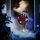 Switzerland's Roger Federer arrives on the court ahead of his singles ATP World Tour tennis finals match against Japan's Kei Nishikori at the O2 arena in London, Tuesday, Nov. 11, 2014. (AP Photo/Tim Ireland)