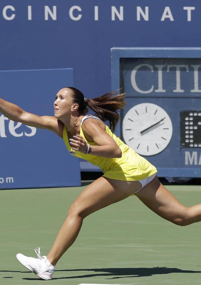 Jelena Jankovic, from Serbia, returns a serve against Serena Williams during a match at the Western & Southern Open tennis tournament, Friday, Aug. 15, 2014, in Mason, Ohio. Williams won 6-1, 6-3