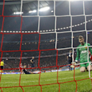 Manchester United's goalkeeper David de Gea reacts after Bayern's Arjen Robben scored his sides 3rd goal during the Champions League quarterfinal second leg soccer match between Bayern Munich and Manchester United in the Allianz Arena in Munich, Germany,