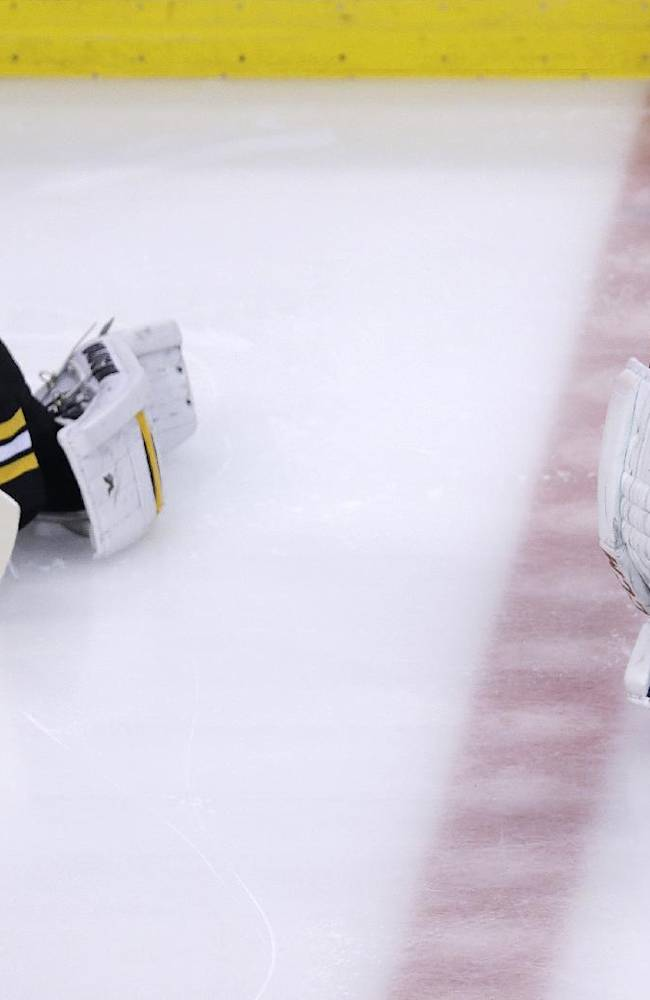Boston Bruins goalie Tuukka Rask (40) and Montreal Canadiens goalie Carey Price (31) stretch before Game 5 in the second-round of the Stanley Cup hockey playoff series in Boston, Saturday, May 10, 2014