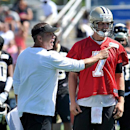 New Orleans Saints head coach Sean Payton left talking with quarterback Luke McCown (7) during an NFL football training camp in White Sulphur Springs W. Va., Saturday, July 26, 2014 The Associated Press
