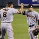 San Francisco Giants' Gregor Blanco and Juan Perez celebrate after Game 1 of baseball's World Series against the Kansas City Royals Tuesday, Oct. 21, 2014, in Kansas City, Mo. The Giants won 7-1 to take a 1-0 lead in the series. (AP Photo/Charlie Riedel)