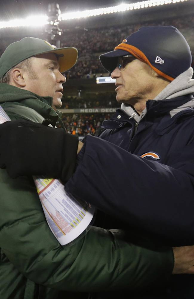 Green Bay Packers head coach Mike McCarthy, left, talks to Chicago Bears head coach Marc Trestman after their NFL football game, Sunday, Dec. 29, 2013, in Chicago. The Packers won 33-28 to capture the NFC North title