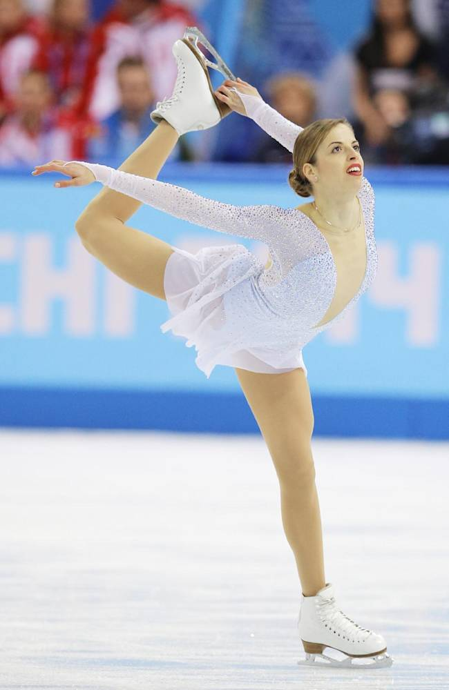 Carolina Kostner of Italy competes in the women's team short program figure skating competition at the Iceberg Skating Palace during the 2014 Winter Olympics, Saturday, Feb. 8, 2014, in Sochi, Russia