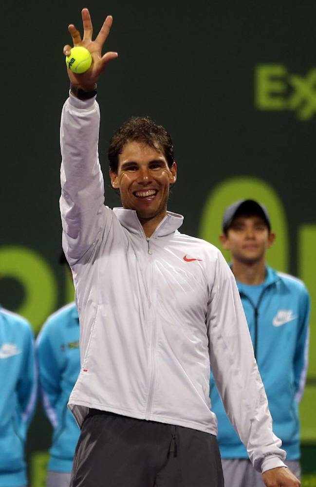Spain's Rafael Nadal celebrates after winning the  final match of the Qatar Open tournament in Doha against France's Gael Monfils on Saturday, Jan. 4, 2014