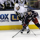 Columbus Blue Jackets' Mark Letestu (55) and Pittsburgh Penguins' James Neal (18) tangle during the third period of an NHL hockey game, Friday, March 28, 2014, in Columbus, Ohio The Associated Press