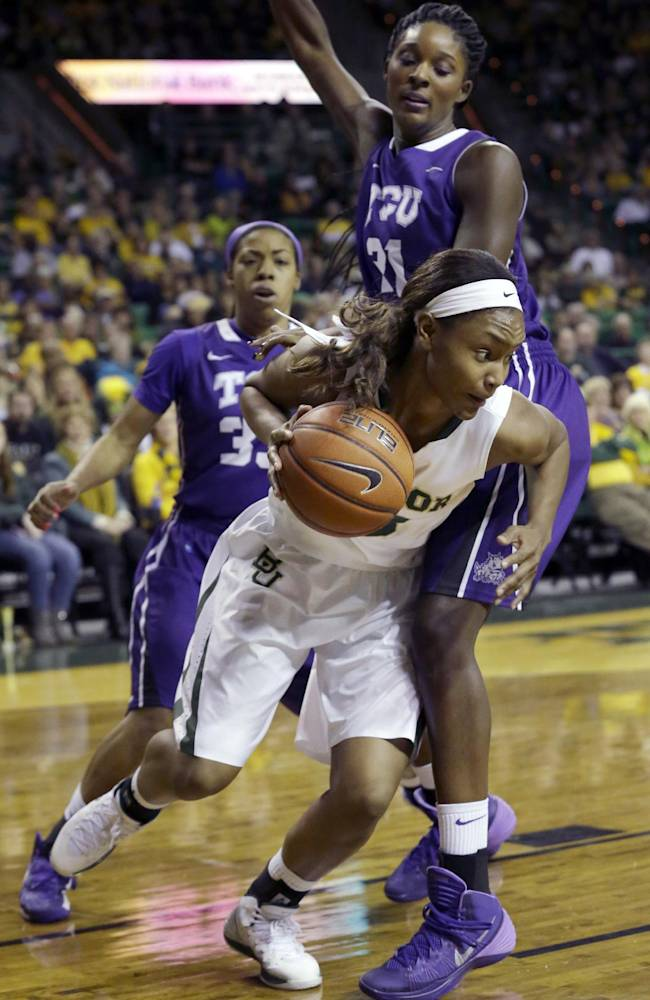 Baylor guard Alexis Prince (12) drives past TCU center Latricia Lovings (21) as guard Donielle Breaux (33) looks on during the first half of an NCAA college basketball game, Saturday, Jan. 11, 2014, in Waco, Texas