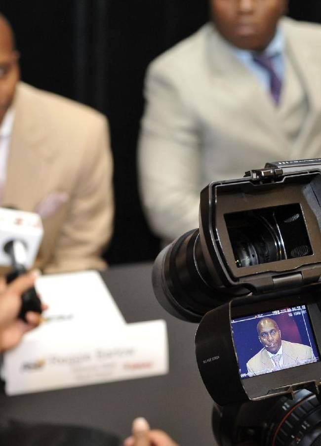 Alabama State head coach Reggie Barlow, displayed on a video camera monitor, answers questions from the media during the Southwestern Athletic Conference NCAA college football media day Friday, July 18, 2014, in Birmingham, Ala