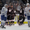 Los Angeles Kings celebrate a empty net goal by right wing Marian Gaborik, as Toronto Maple Leafs' Phil Kessel, left, and Jake Gardiner skate off during the third period of an NHL hockey game in Los Angeles, Monday, Jan. 12, 2015 The Associated Press