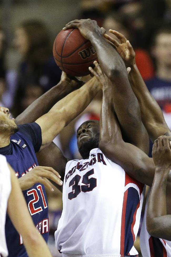Gonzaga's Sam Dower (35) and Gary Bell, Jr., second from right, fight to hold onto the ball as South Alabama's Augustine Rubit (21) tried to take it away in the second half of an NCAA college basketball game, Saturday, Dec. 14, 2013, in Seattle.  Gonzaga beat South Alabama 68-59
